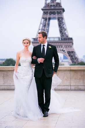 Bride and Groom Walking Arm in Arm Near Eiffel Tower